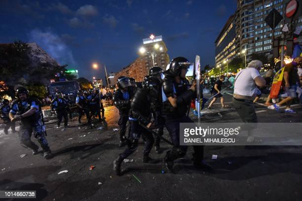Romanian anti riot police clash with protesters during a demonstration in front of the Romanian Government headquarters in Bucharest August 10 to...