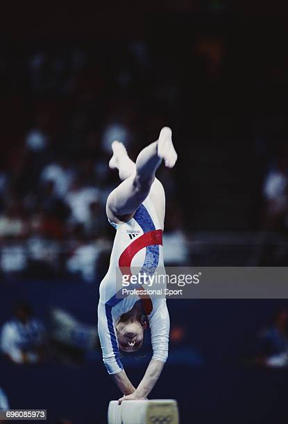 Romanian artistic gymnast Andreea Raducan pictured in action competing for Romania on the balance beam during competition to win the gold medal in...