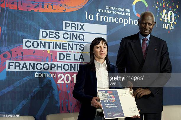 Romanian author Liliana Lazar, winner of ''The Prize of Five Continents de la Francophonie'' for her novel entitled �Terre des Affranchis� , flanked...