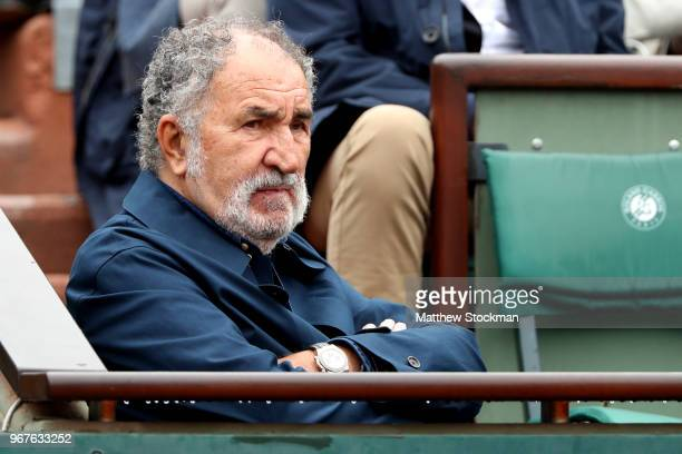 Romanian businessman Ion Tiriac watches on during the mens singles quarter final match between Alexander Zverev of Germany and Dominic Thiem of...