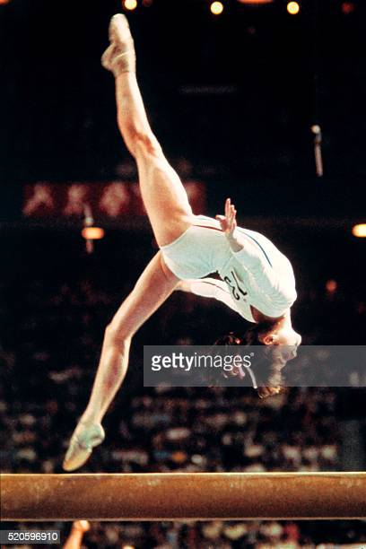 Romanian champion Nadia Comaneci aged 14 performs during the women's beam of the artistic gymnastics event of the Montreal Olympic Games on July 21...