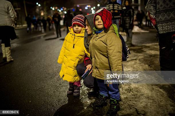 Romanian children are seen during a protest against corruption and the new Romanian government's plans to pardon prisoners during a rally in...