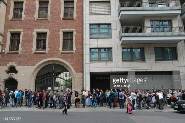 Romanian citizens line up near the Romanian Embassy to cast their ballots in European parliamentary elections on May 26 2019 in Berlin Germany Today...