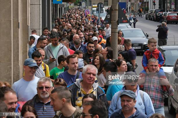 Romanian citizens line up outside the Romanian Embassy to cast their ballots in European parliamentary elections on May 26 2019 in Berlin Germany...