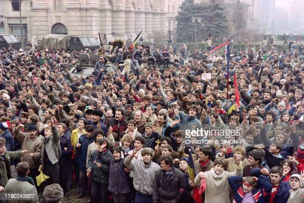 Romanian civilians join the army in a support demonstration to the National Salvation Front Council to overthrow the Socialist Republic of Romania,...
