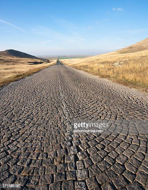 romanian country road - paving stone stock pictures, royalty-free photos & images
