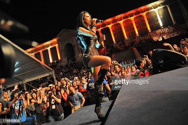 WESSELINGH Romanian dance music singer INNA plays during her very first concert in Bucharest on May 17 2011 Alexandra Apostoleanu aka Inna is one of...