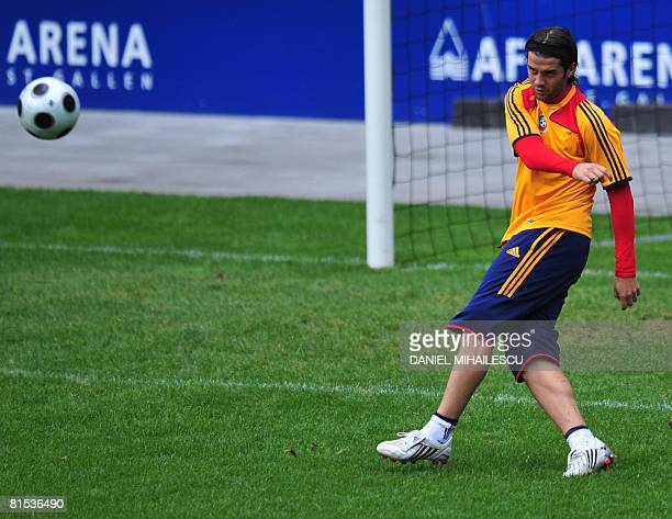 Romanian defender Cristian Chivu kicks the ball during a training session on the eve of their match against Italy at AFG Arena stadium on June 12...