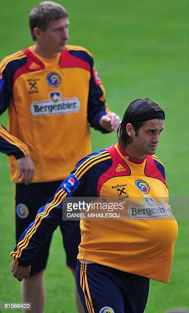 Romanian defender Cristian Chivu walks wearing a ball under his tshirt next to defender teammate Dorin Goian during a training session at AFG Arena...