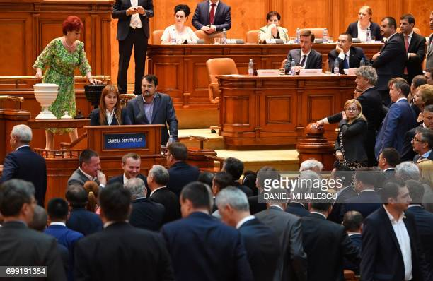 Romanian delegates cast their ballots for the vote on a motion of censure against Romanian Prime Minister Sorin Grindeanu during a session of the...