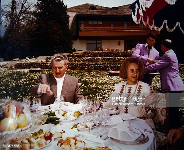 Romanian dictator Nicolae Ceausescu and his wife Elena eating a lavish dinner in an undated photograph from their family album During his rule...