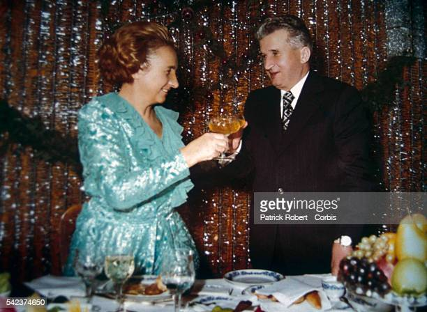 Romanian dictator Nicolae Ceausescu and his wife Elena share a toast in an undated photograph from their family album During his rule beginning in...