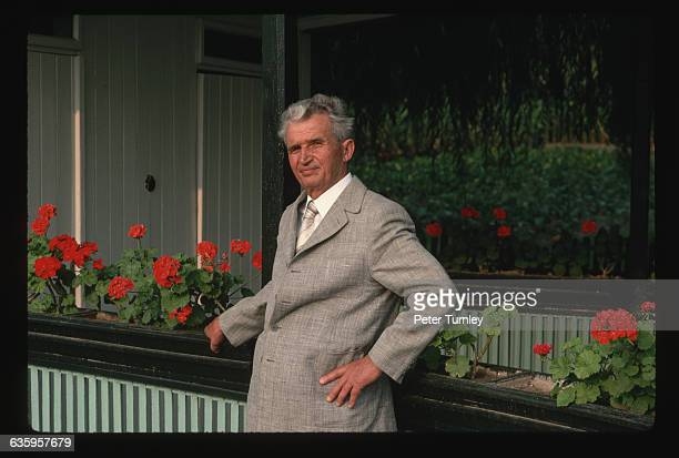 Romanian dictator Nicolae Ceausescu poses casually beside blooming geraniums on the porch of his villa near Bucharest in August 1989 | Location Near...