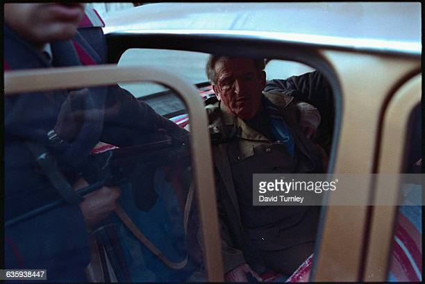 Romanian dictator Nicolae Ceausescu sits in a car at gunpoint after attempting to escape the country's overthrow of the government Three days later...