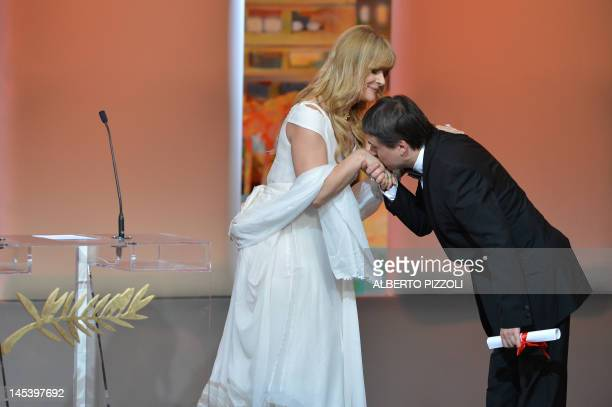 Romanian director Cristian Mungiu kisses the hand of German actress Nastassia Kinski after being awarded with the Best Screenplay award for the film...