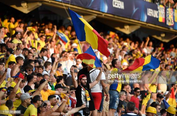 Romanian fans celebrate after the 2019 UEFA U21 Group C match between England and Romania at Dino Manuzzi Stadium on June 21 2019 in Cesena Italy...