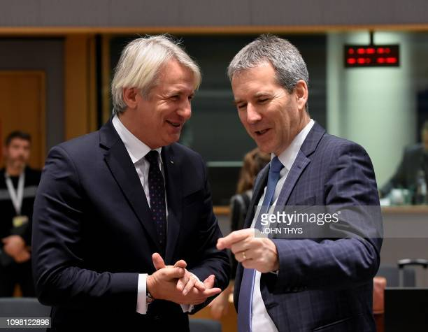 Romanian Finance minister Eugen Orlando Teodorovici talks with Austrian Finance Minister President of the Council Hartwig Loeger before an Ecofin...