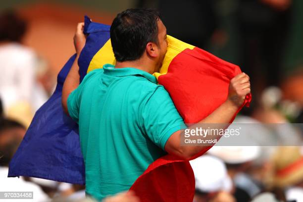 Romanian flag is held in the stands in support of Simona Halep of Romania during her ladies singles final against Sloane Stephens of The United...