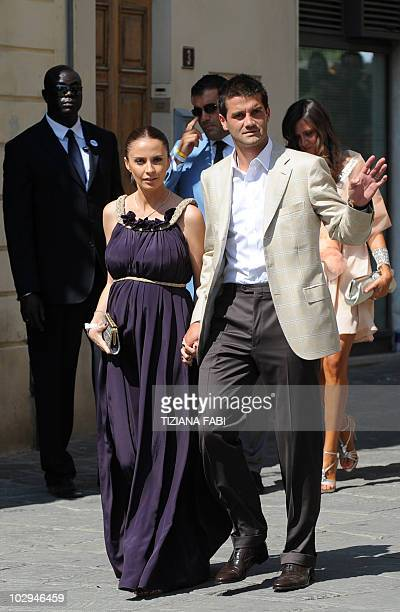 Romanian football player Christian Chivu and his wife Adelina arrive in Siena on July 17, 2010 to follow Inter-Milan's teammate, Netherland's Wesley...