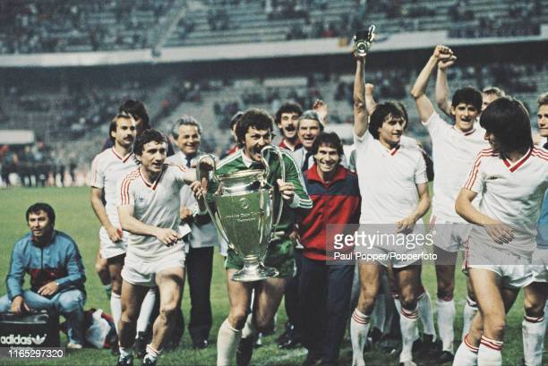 Romanian footballer Helmuth Duckadam goalkeeper with Steaua Bucuresti pictured holding the European Cup trophy during celebrations with his teammates...