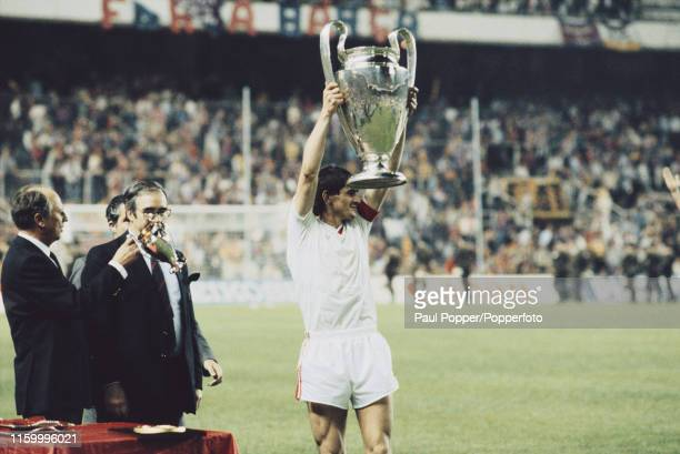 Romanian footballer Stefan Iovan defender and captain of Steaua Bucuresti pictured celebrating with the European Cup trophy after Steaua Bucuresti...