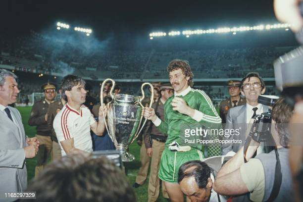 Romanian footballers Anghel Iordanescu and Helmuth Duckadam midfielder and goalkeeper with Steaua Bucuresti pictured together holding the European...