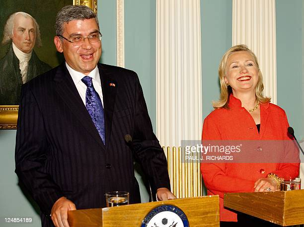 Romanian Foreign Minister Teodor Basconschi and US Secretary of State Hillary Clinton smile while delivering remarks on their signing a Ballistic...