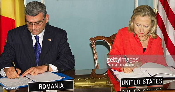 Romanian Foreign Minister Teodor Basconschi and US Secretary of State Hillary Clinton sign a Ballistic Missile Defense Agreement between the US and...