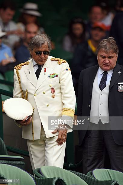 Romanian former tennis player Ilie Nastase takes his seat in the royal box on centre court on day seven of the 2015 Wimbledon Championships at The...