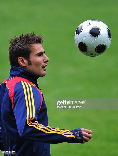 Romanian forward Adrian Mutu plays with the ball during a training session on the eve of their match against Italy at AFG Arena stadium on June 12...