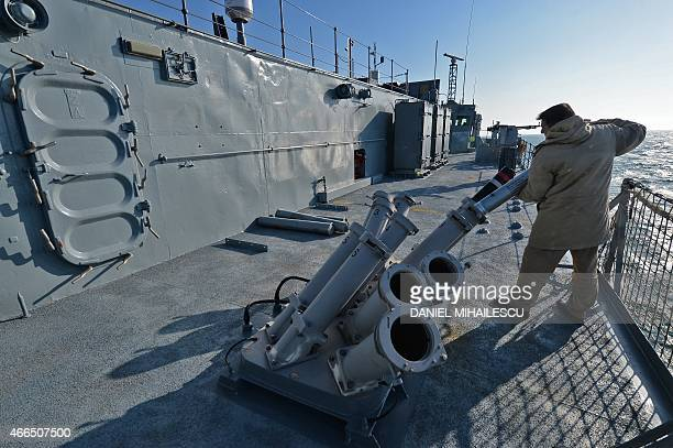 Romanian frigate Regina Maria personel with the NATO Standing Maritime Group2 loads a rocket during a military drill on the Black Sea 60km from...