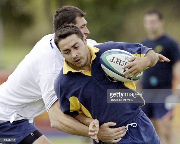 Romanian fullback Iulian Andrei practices at Shaw Sportz field during a training session in Brisbane 15 October 2003 Romania will meet Australie in...