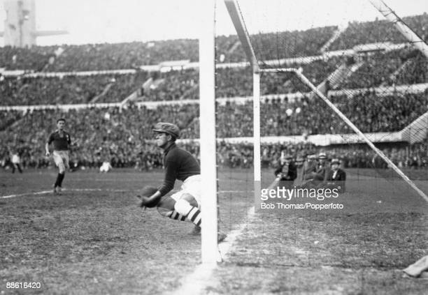 Romanian goalkeeper Ion Lapusneanu gathers the ball during the FIFA World Cup match between Uruguay and Romania at the Estadio Centenario in...