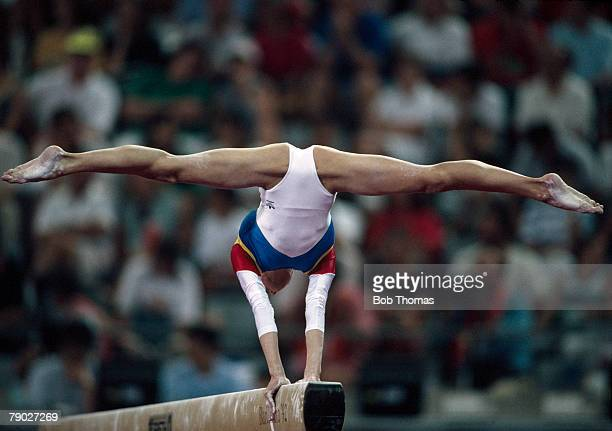 Romanian gymnast Gina Gogean competes in the Women's balance beam event part of the Women's artistic team allaround gymnastics competition at the...