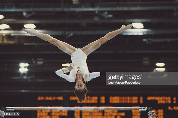 Romanian gymnast Nadia Comaneci pictured in action during competition on the uneven bars event part of the women's artistic team allaround...