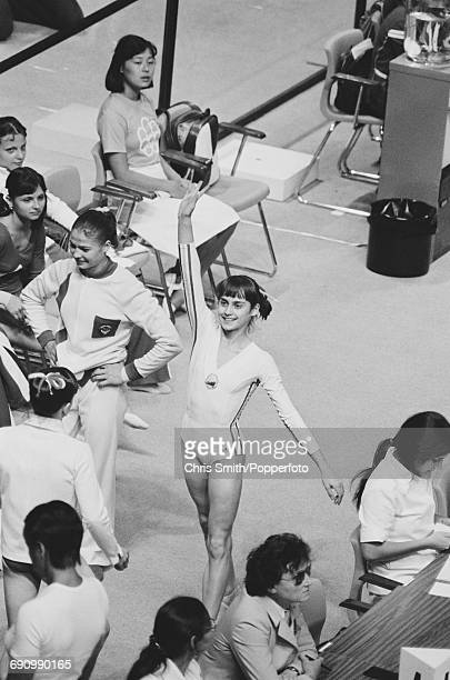 Romanian gymnast Nadia Comaneci pictured waving after competition in the floor exercise part of the women's artistic team allaround competition at...