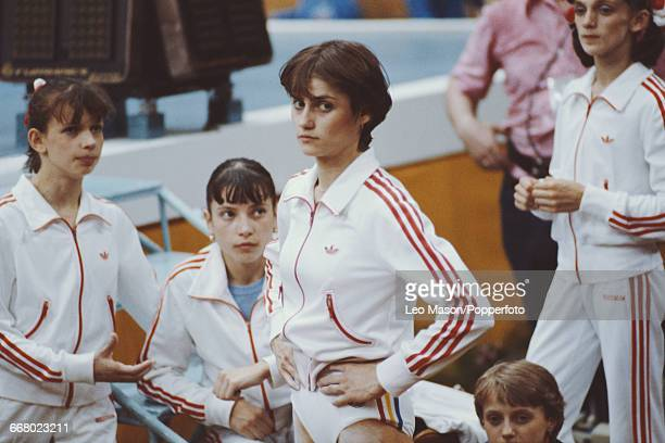 Romanian gymnast Nadia Comaneci pictured with her teammates during competition in the women's artistic team allaround competition at the 1980 Summer...