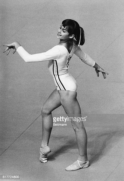 Romanian gymnast Nadia Comaneci smiles as she performs in the floor exercise competition at the 1976 Summer Olympics in Montreal Canada She would go...