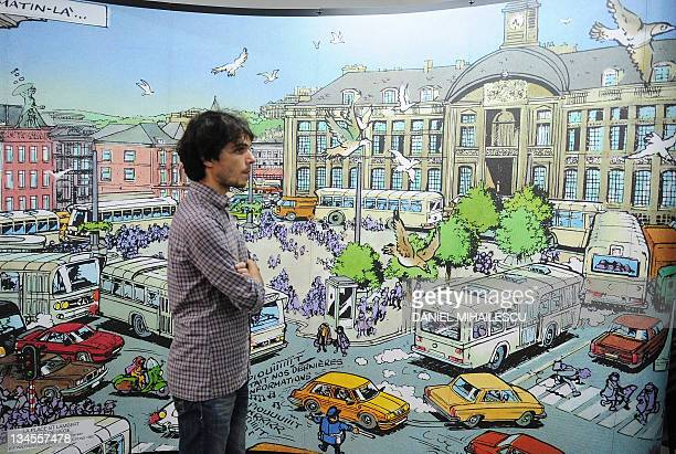 A Romanian highschool student looks at the comic strip prints at The European comics festival exhibition in Bucharest on November 4 2011 The European...