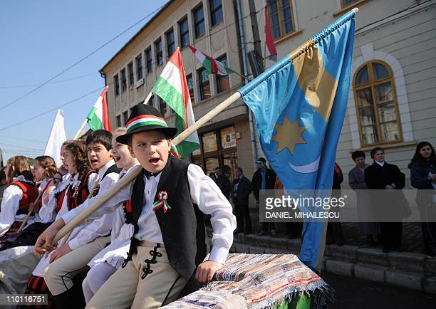 Romanian Hungarians wearing traditional outfits attend a parade in Targu Secuiesc 290 km north from Bucharest on March 15 2011 Thousands from central...