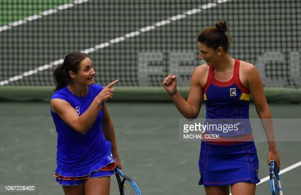 Romanian Irina-Camelia Begu and Monica Niculescu react during the Fed Cup tennis match against Czech Republic's Barbara Krejcikova and Katerina...