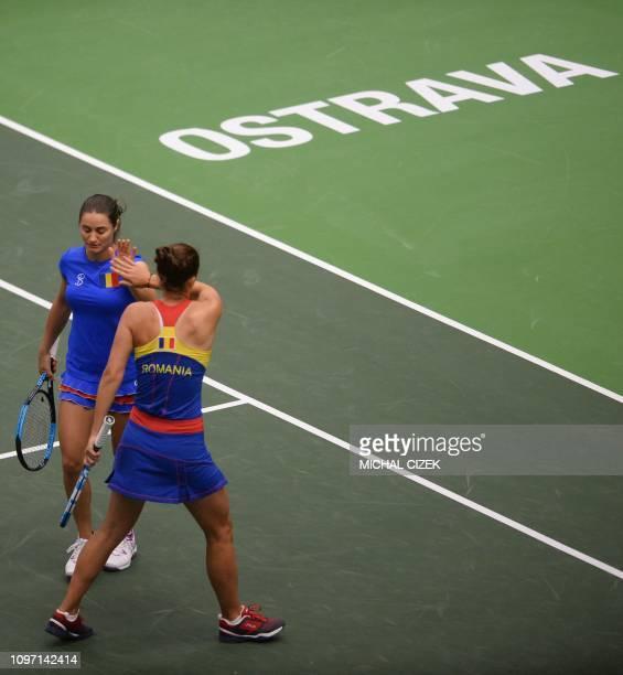 Romanian Irina-Camelia Begu and Monica Niculescu react during their doubles match against Czech's Barbara Krejcikova and Katerina siniakova in their...