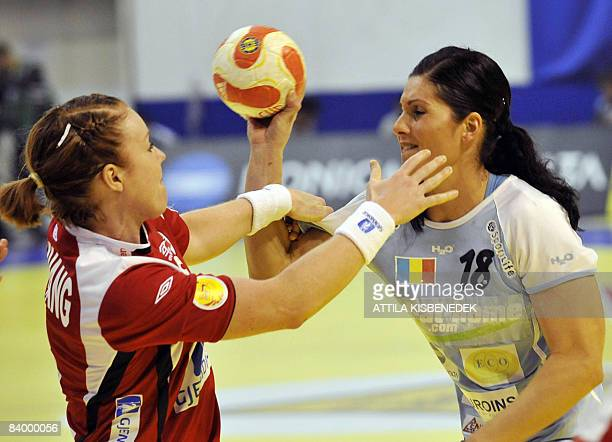 Romanian Laura Fiera fights for the ball with Norwegian Karoline Breivang during the 8th Women's Handball European Championships match on December 11...