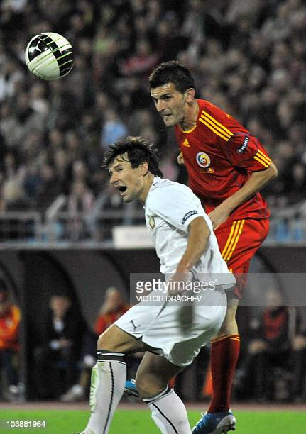 Romanian Marius Bilasco vies with Belarus' Vitali Kutuzov during their Euro 2012 group D qualifying match on September 7, 2010 in Minsk. AFP PHOTO /...