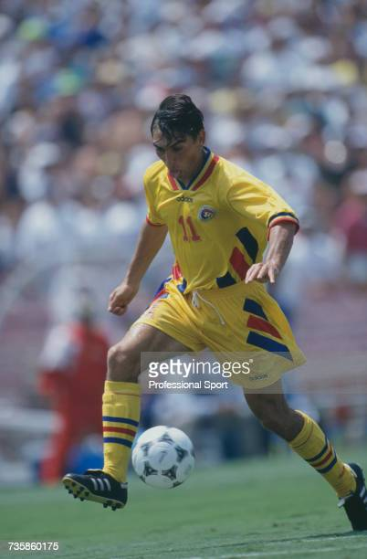 Romanian midfielder Ilie Dumitrescu pictured in action making a run with the ball in the 1994 FIFA World Cup knockout stage round of 16 match between...
