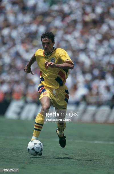 Romanian midfielder Ioan Lupescu pictured in action making a run with the ball in the 1994 FIFA World Cup knockout stage round of 16 match between...