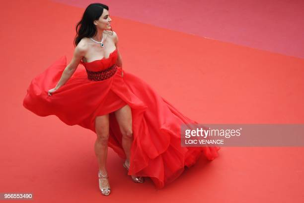 Romanian model Catrinel Menghia poses as she arrives on May 9 2018 for the screening of the film Yomeddine at the 71st edition of the Cannes Film...