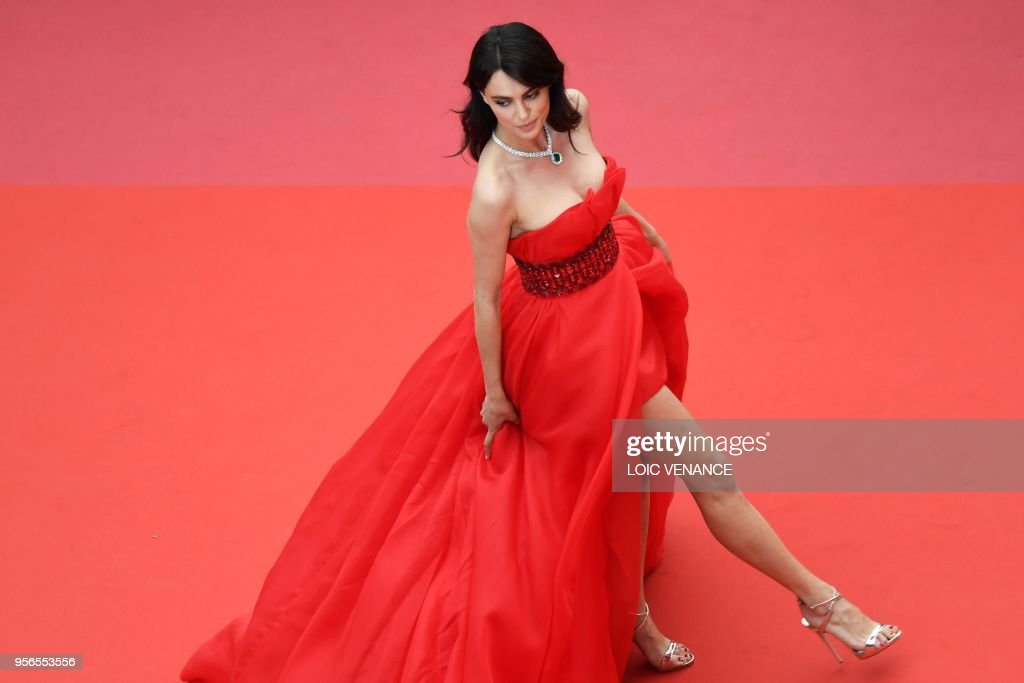 Romanian model Catrinel Menghia poses as she arrives on May 9, 2018 for the screening of the film 'Yomeddine' at the 71st edition of the Cannes Film Festival in Cannes, southern France.