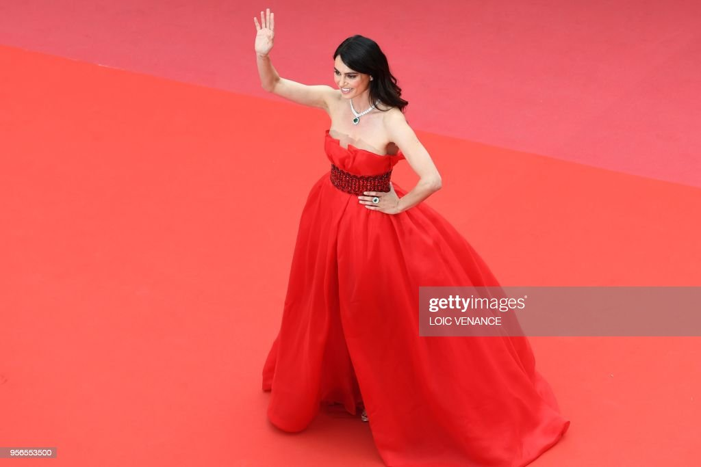 Romanian model Catrinel Menghia waves as she arrives on May 9, 2018 for the screening of the film 'Yomeddine' at the 71st edition of the Cannes Film Festival in Cannes, southern France.