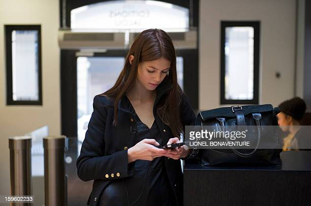 LACUT Romanian model Ioana Timoce looks at her phone as she waits for a meeting in a magazine's office on January 16 2013 in Paris Ioana Timoce works...